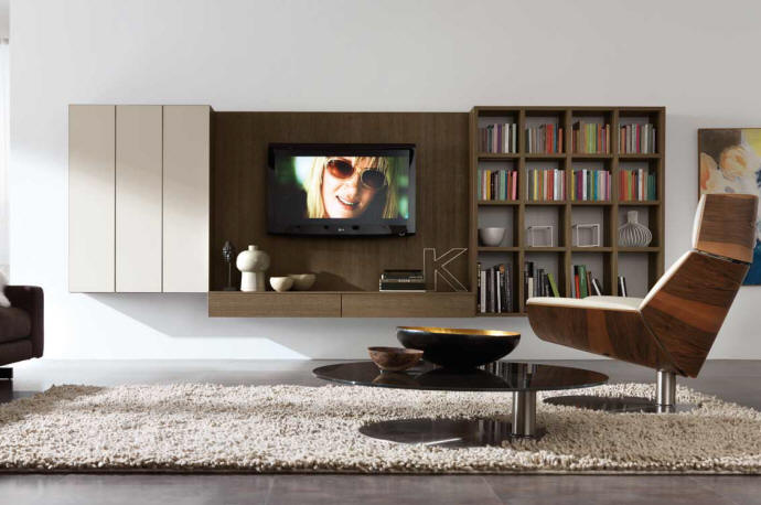 Arrange your bookshelves to look interesting, eclectic and organized