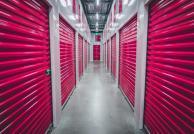 Pink storage doors in a hallway.
