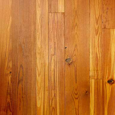 Also known as flat sawn this cut produces a wide cathedral pattern or arching grain. The end of the board shows somewhat horizontal lines.This is tongue & groove pine flooring.  This is our best seller. With at least 98% heart content, this beautiful floor becomes richer and darker with each year. Some boards may be clear, some may have small tight knots, and a few small nail holes may be present.