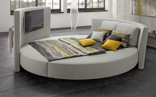 Cinemaro - Luxurious round bed with a media highlight